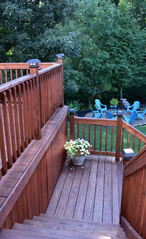 Pressure treated wood deck with dark oak stain color.