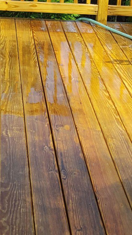 Pressure treated wood deck being cleaned
