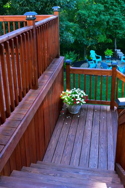Tips for staining and sealing a pressure treated wood deck.