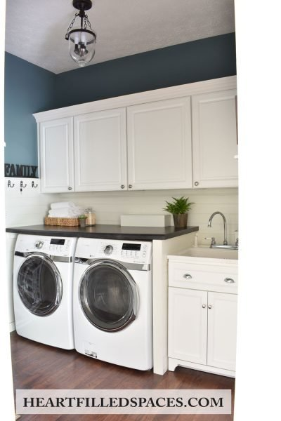 Blue and white shiplap farmhouse laundry room