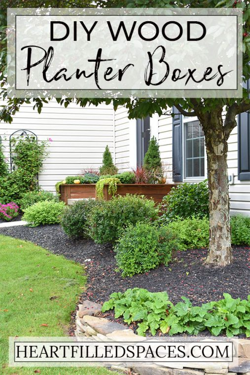 DIY planter boxes and beautiful landscape in front yard.