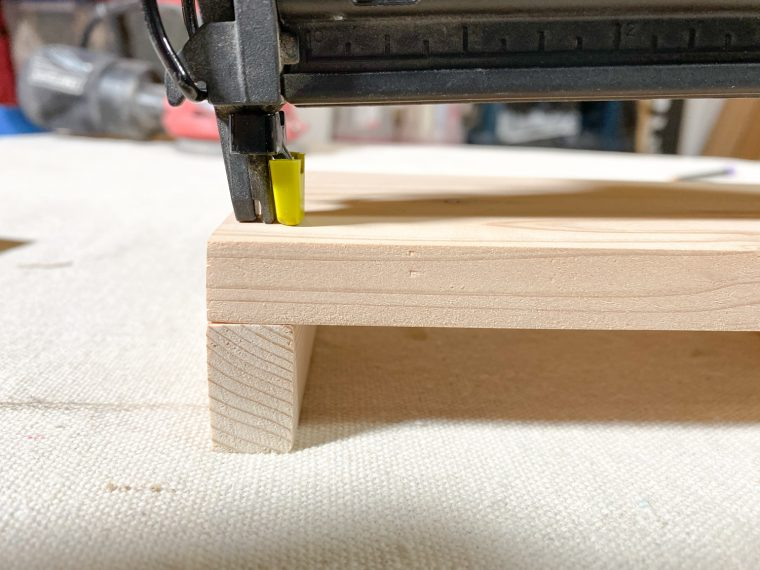 How to assemble a wood soap caddy, attach the side pieces.
