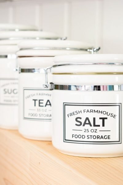 Farmhouse pantry labels on whit canisters.