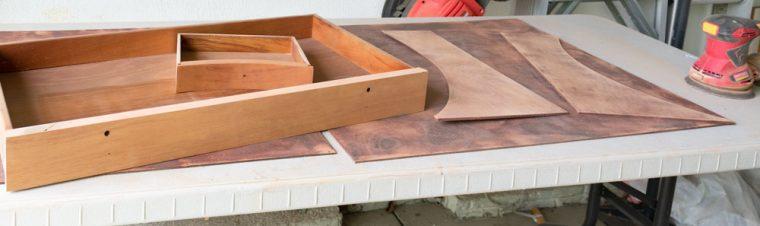 Refinishing an old antique corner desk.