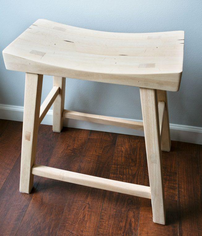 Sanded raw wood on saddle stool.