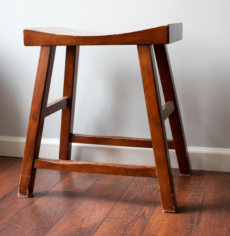 Before picture of saddle stool.