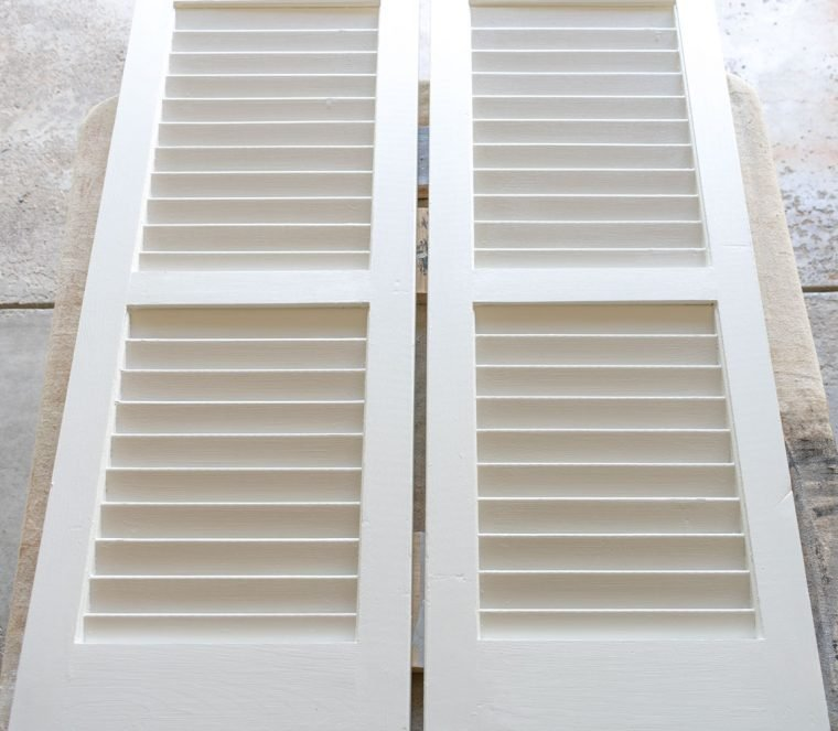 Process for painting shutters for a driftwood finish.