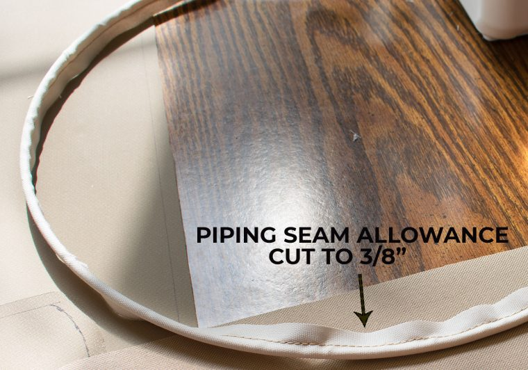Cutting the seam allowance to right size on piping.