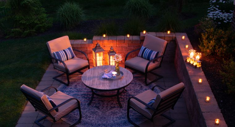 Outdoor patio with candles at night.