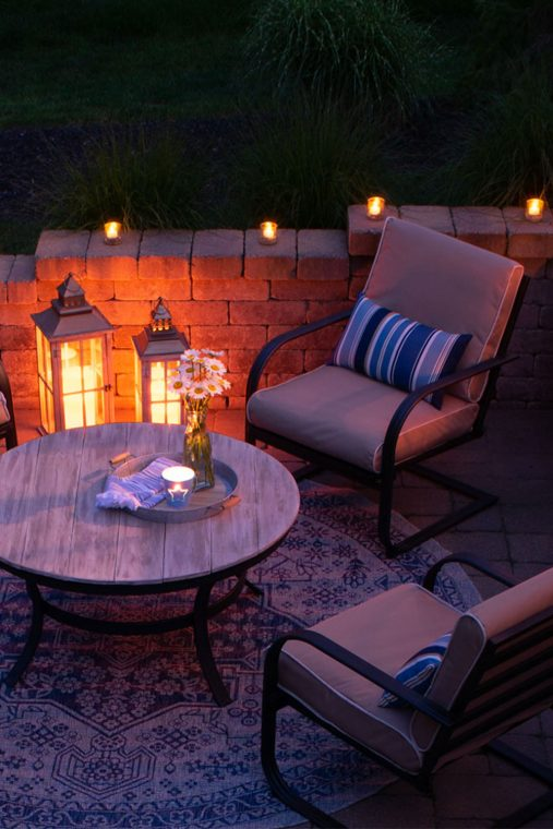 Beautifully updated patio with candles in the evening.