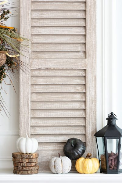 Easy DIY driftwood paint finish on shutters.