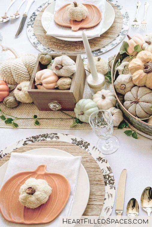 Pumpkin centerpiece on a Thanksgiving table.