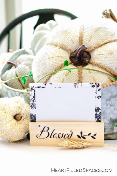 How to make simple DIY place card holders from paint sticks to spruce up your Thanksgving Table.