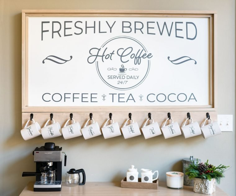 Coffee bar sign with hooks for coffee cups.