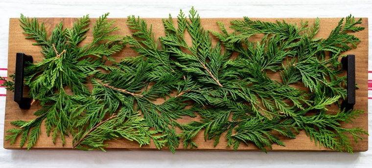 Greenery on DIY wood centerpiece.