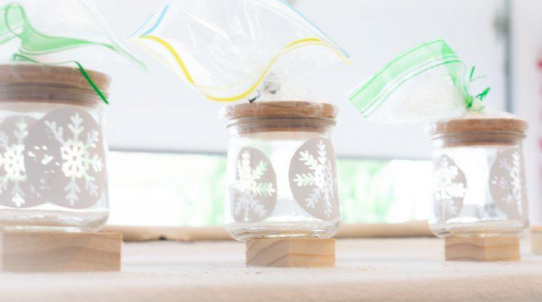Preparing glass jars for spray paint.