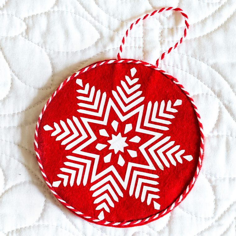 Red and white felt snowflake ornament for Christmas.