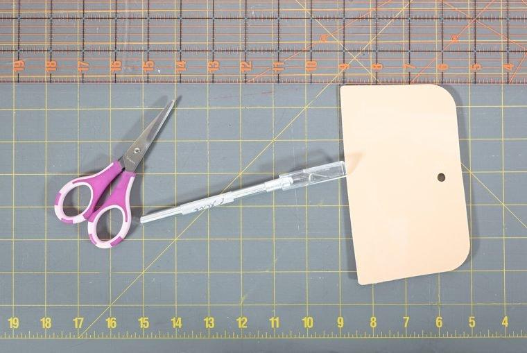 Supplies to apply a wallpaper backsplash.