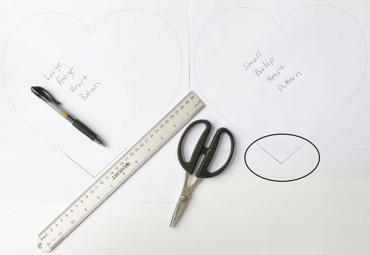 Using the PDF template to make no-sew burlap heart pillows.