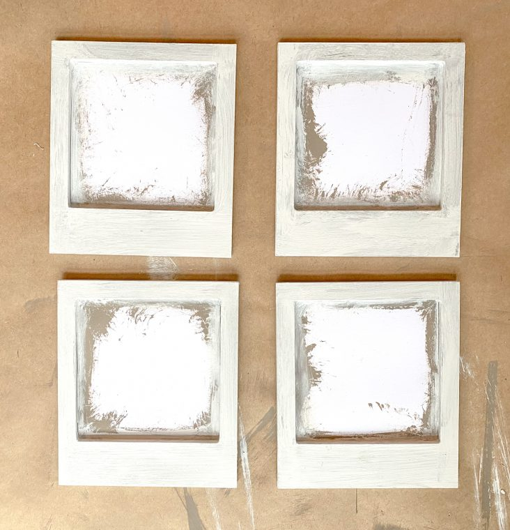 How to paint inexpensive frames for a rustic farmhouse finish.