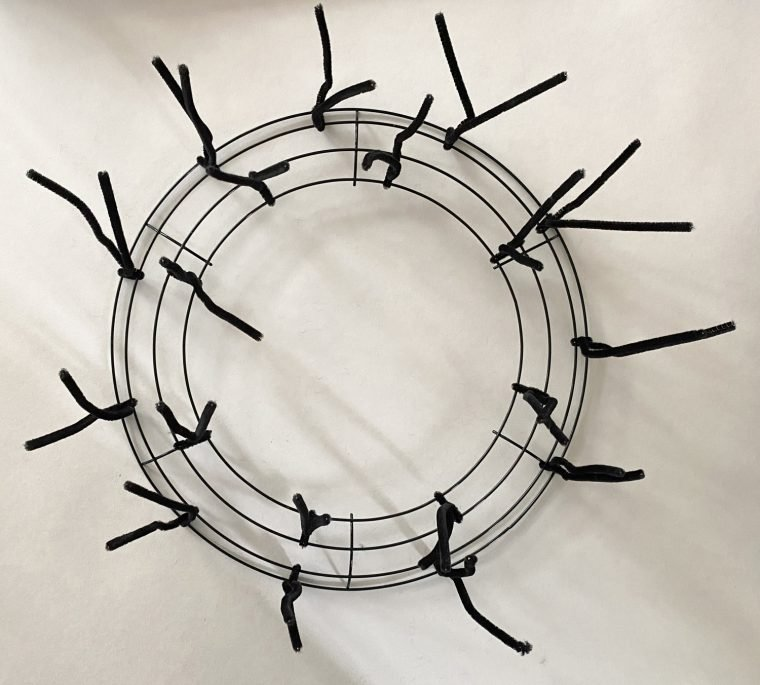 How to make a work wreath from a wire frame and chenille stems.