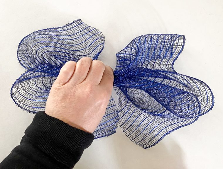 How to cut and bunch deco mesh to attach it to a wire frame for a deco mesh ribbon wreath.