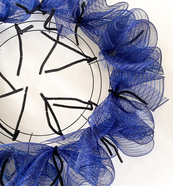 How to add deco mesh to a work wreath with chenille stems.