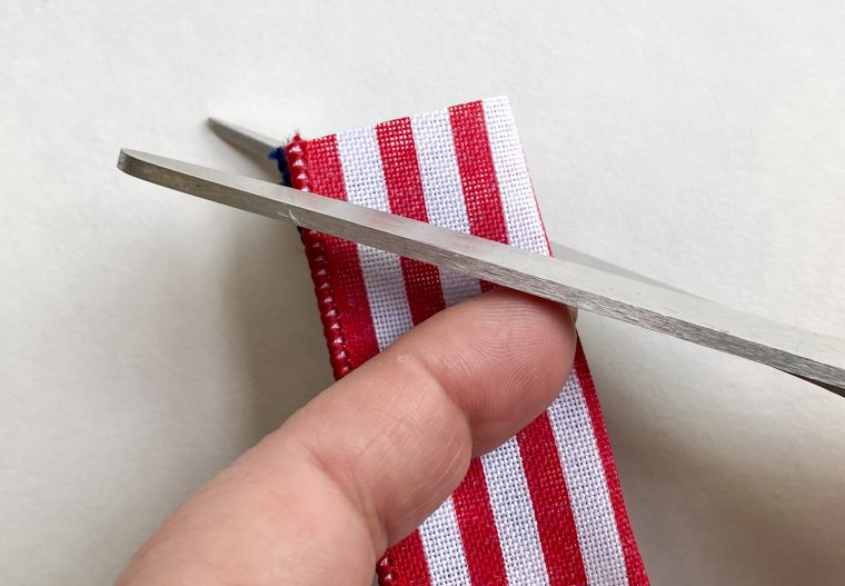 How to cut dovetails on ribbon for a deco mesh and ribbon wreath.