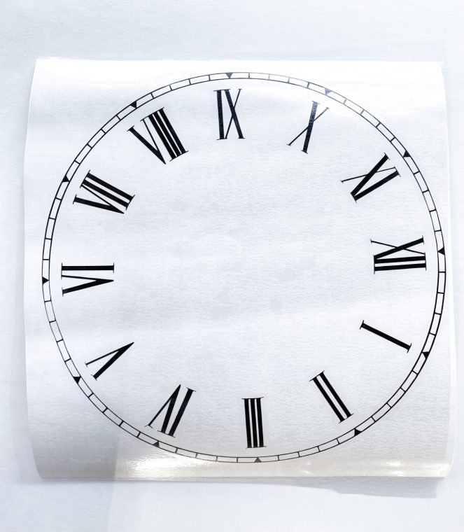 How to use vinyl to add a clock face to a tabletop.