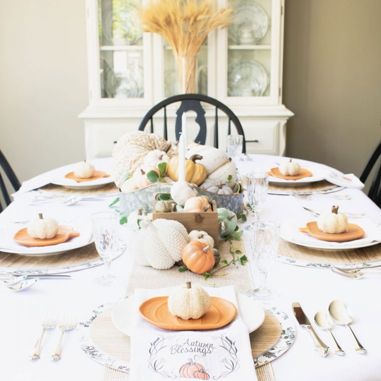 Thanksgiving table setting for fall with pumpkins, wheat, and farmhouse centerpiece.