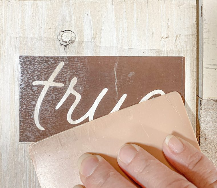 How to use vinyl to make a stencil for paint on a farmhouse sign.
