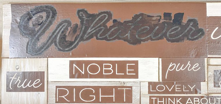 How to stencil paint on a DIY farmhouse sign.