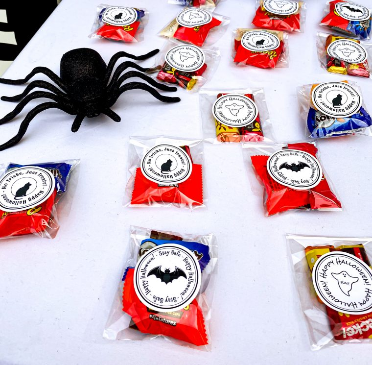 Setting up a treat table for Halloween with social distancing in mind. Free printable files for treat bag labels, Halloween signs, and fun hand sanitizer labels.