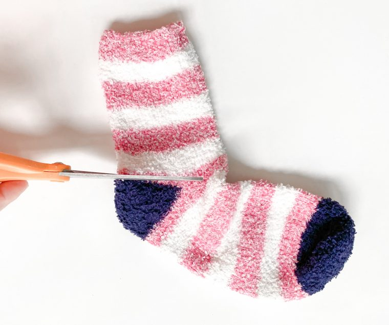 Cut a fuzzy sock to make a hat for your snowman.