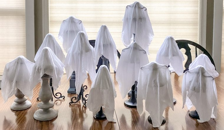 Place your ghost forms on candle sticks to dry.