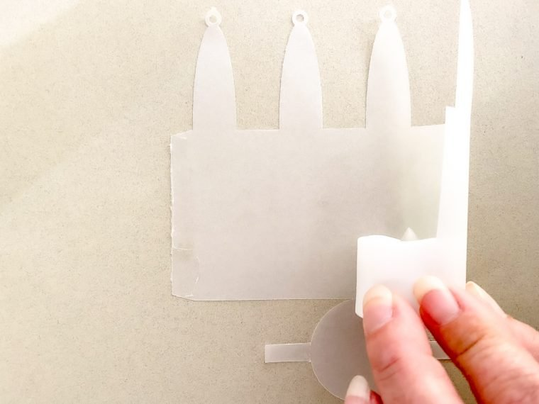 Assemble your vellum tea light hanger to place under your ghosts.
