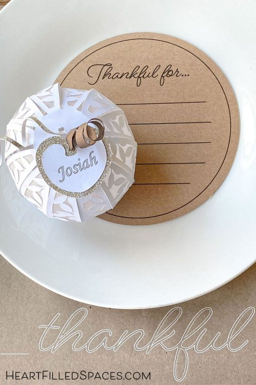 Homemade place mats, place cards and gratitude cards adorn this casual Thanksgiving table.