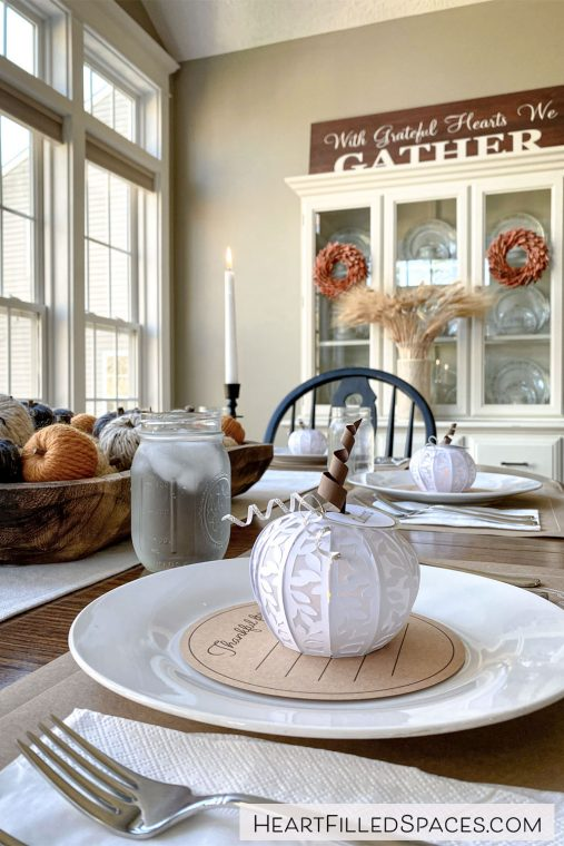 Homemade place cards, gratitude cards and place mats adorn this simple Thanksgiving table.