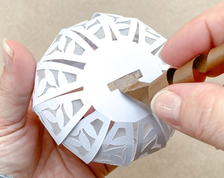 Add the stem to your paper pumpkin.