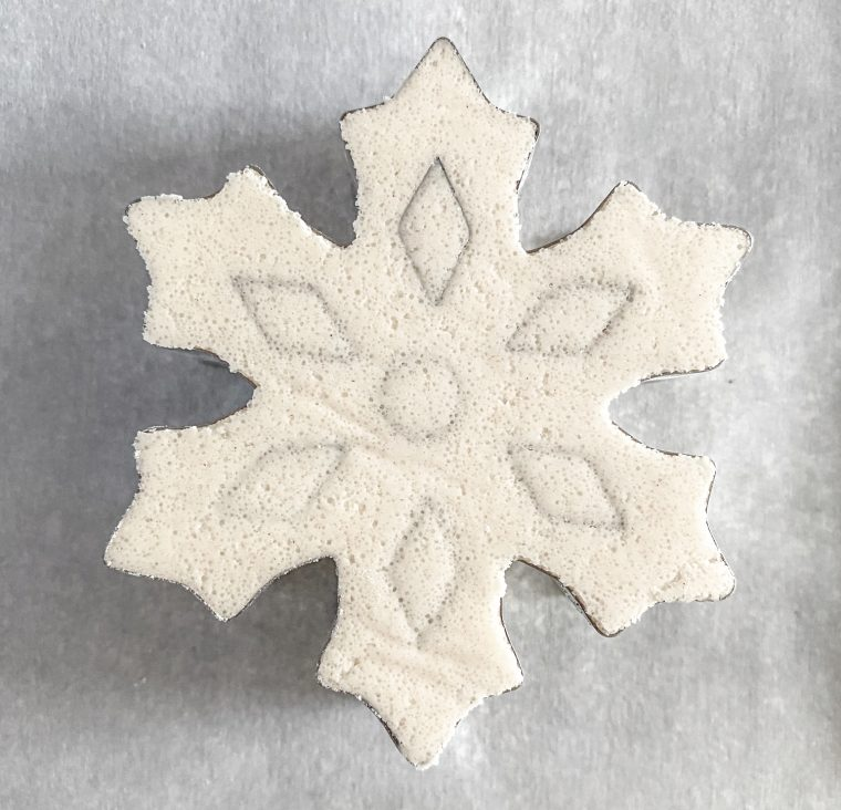 Back of snowflake cookie cutter once pressed.