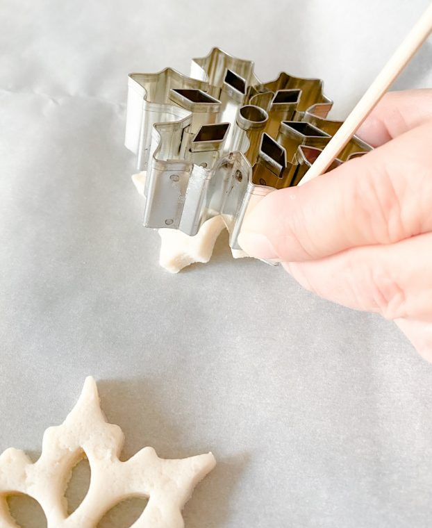 Use a skewer to help remove dough from cutter.