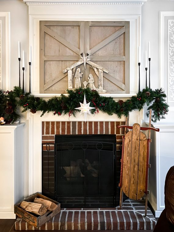 Christmas fireplace mantel with manger scene and DIY paper Christmas star.