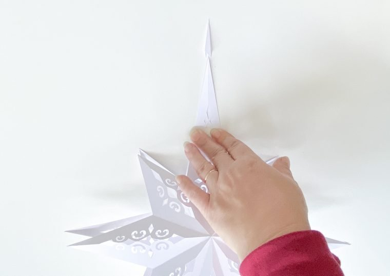 How to assemble a paper Christmas Star craft.