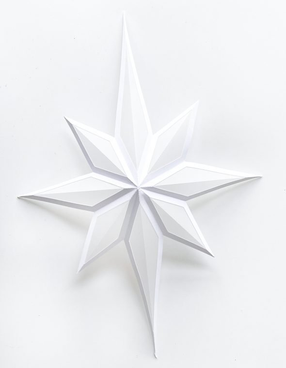 How to fold a paper Christmas star to create a luminary.