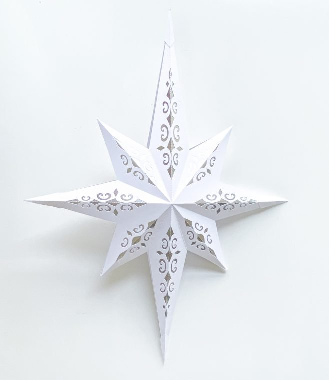 Paper Christmas star craft with free printable SVG cut files.