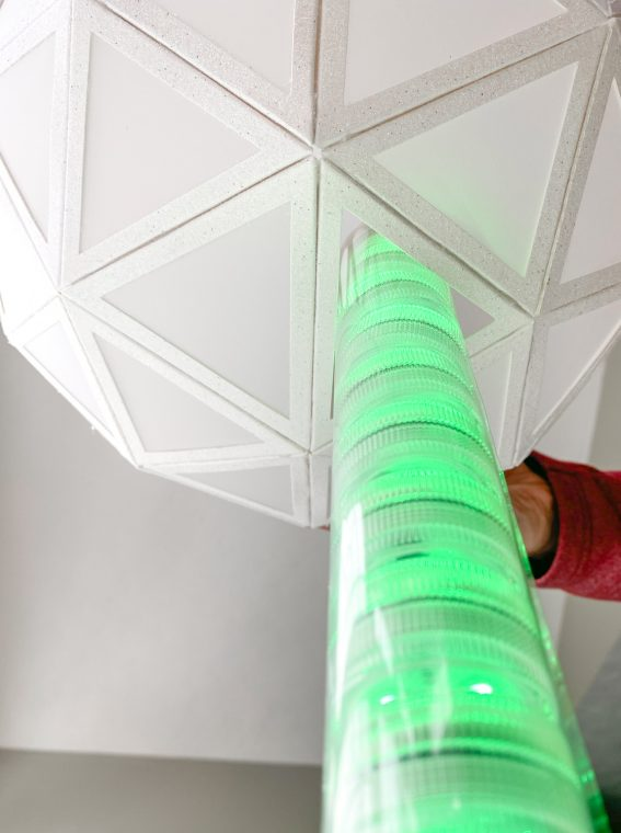 Slide the ball over your light tube to create your New Years Craft.