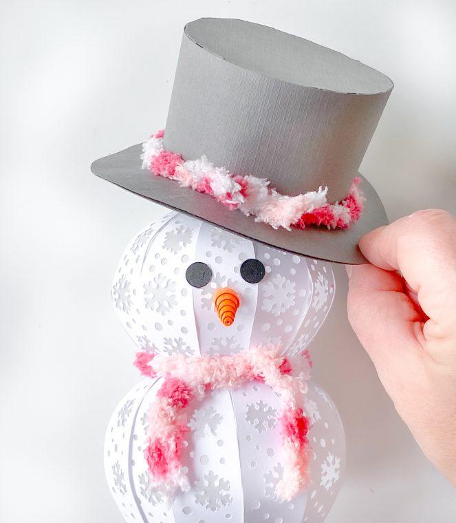Assembling a 3D paper snowman.