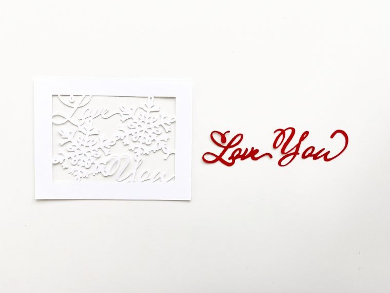 Adding adhesive to a handmade Valentine's Day card.