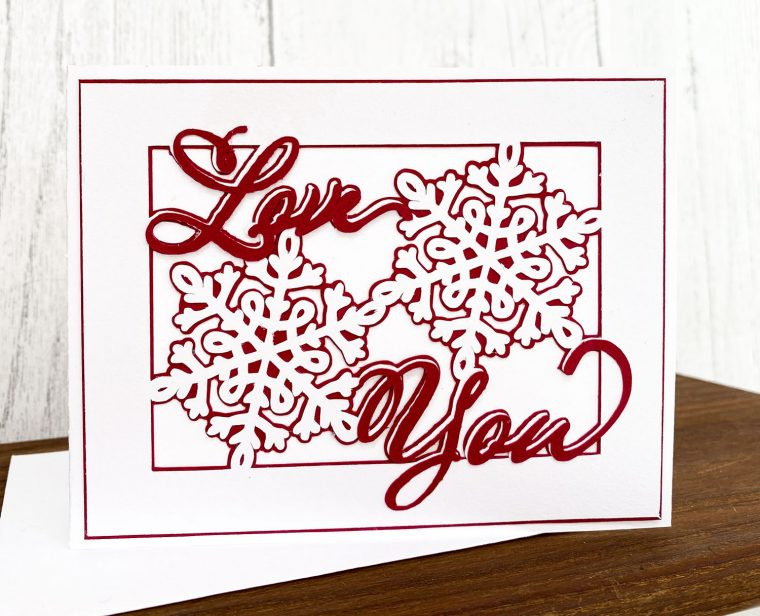 Valentine's Day SVG Love You saying with snowflakes for a card.
