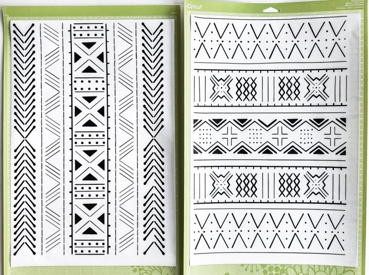 Two mudcloth patterned line art images cut from vinyl to create DIY wall art.